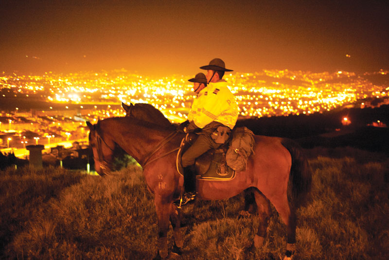 Mounted police in Bogotá by Piers Calvert