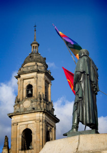 Simon Bolivar holds a gay pride flag in Bogotá