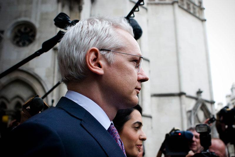 Julian Assange leaves a court house in London.