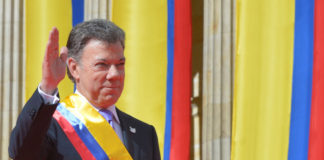 Santos wears the presidential sash during this inauguration.