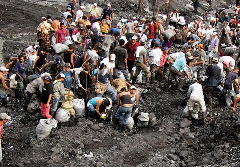 Guaqueros work the sludge at the Muzo mine, in search of the elusive emerald.