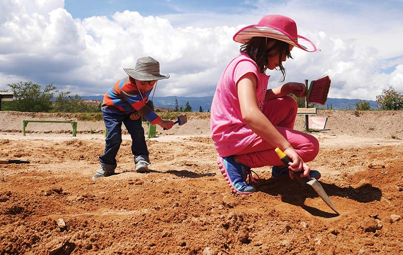 Children play excavate near Villa de Leyva, Boyacá.