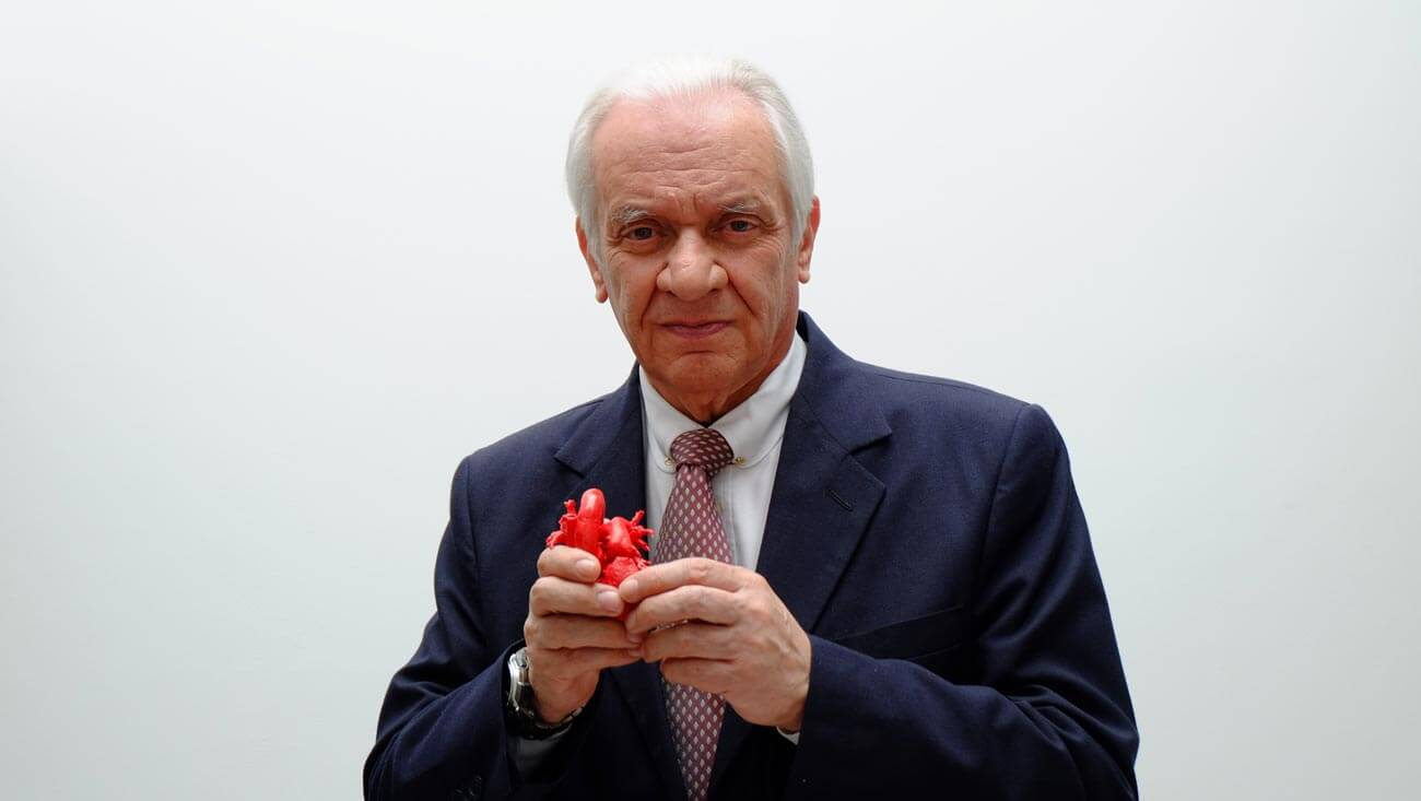 Dr. Jorge Reynolds holds a model of a human heart