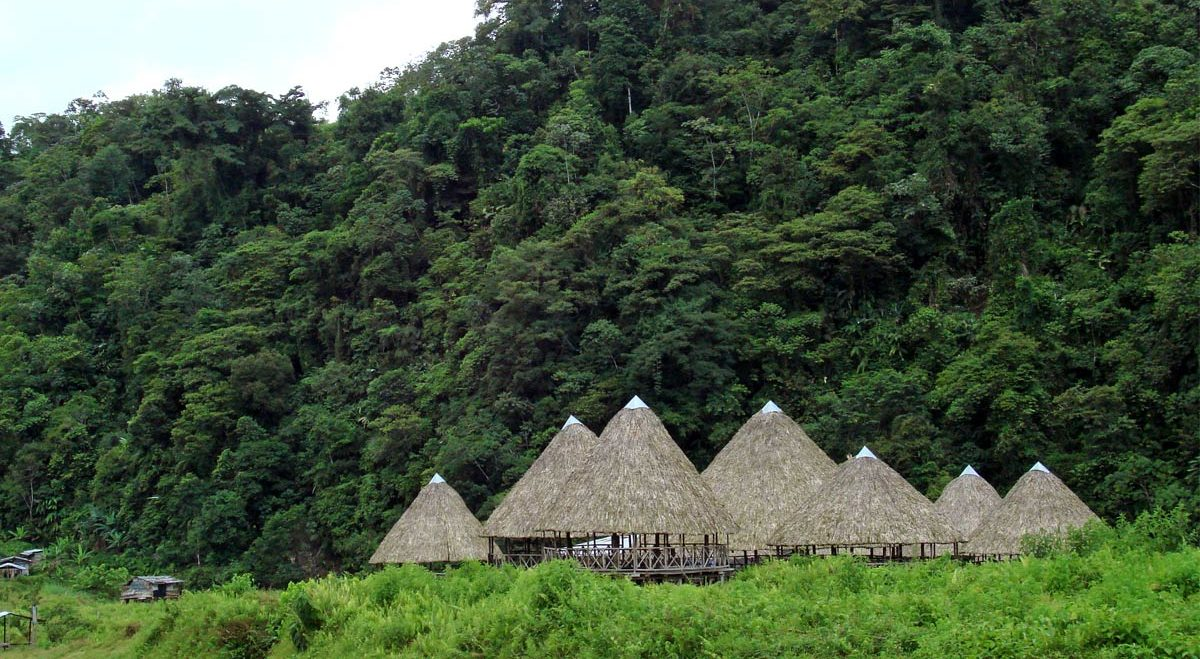 Embera huts dot the roadside in Mutatá.