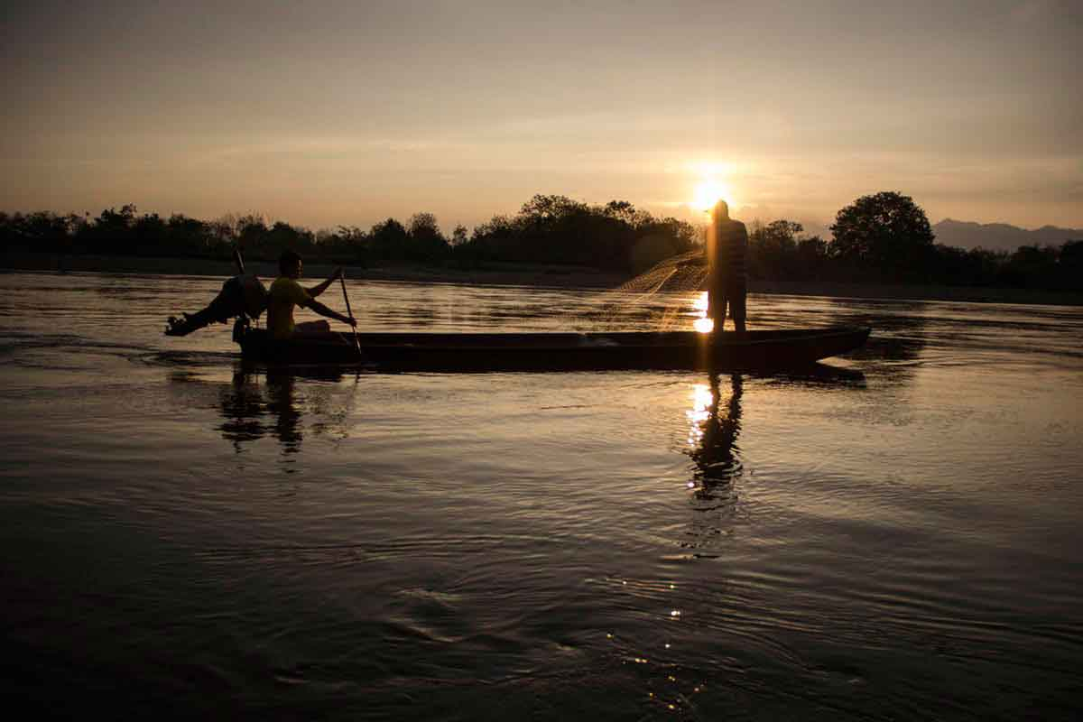 Fishermen cast their nets in the Magdalena River near Colombia's Tatacoa Desert