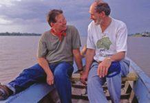Thomas Defler and John Lynch journey down the Amazon looking for monkeys. (Photo by Richard Emblin)
