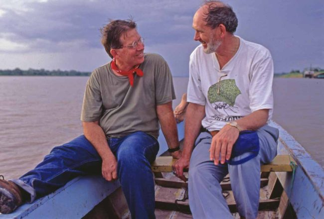 Thomas Defler and John Lynch journey down the Amazon looking for monkeys. (Photo by Richard Emblin)